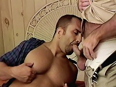 Gay bear Patrick Ives getting nude and hot on a sizzling one on one hardcore blowjob action