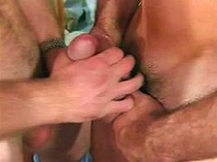 Smooth unshaved gay couple caressing their cock while standing